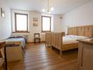 appartamenti-selva-cadore-rododendro-camera-matrimoniale-letto